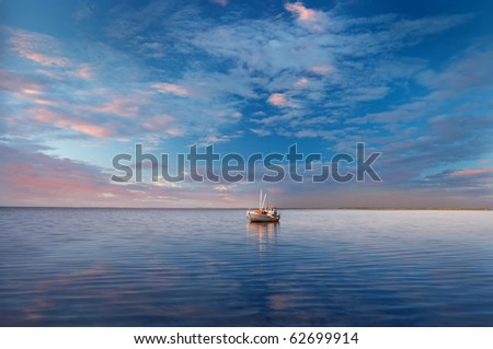 Boat under the summer sky - stock photo