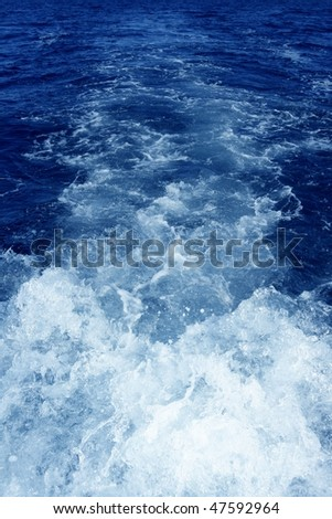 Boat wake foam water propeller wash blue saltwater - stock photo