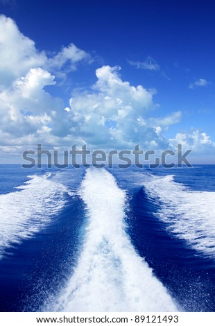 Boat wake prop wash on blue ocean sea in sunny day - stock photo