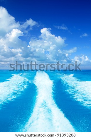 Boat wake prop wash on turquoise sea in sunny day - stock photo