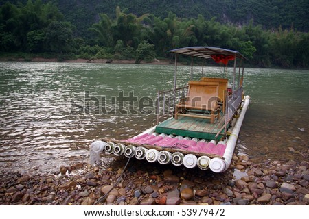 Boat which is used for traveling along Li River - stock photo