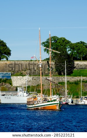 Boat with Akershus Fortress on background, Oslo, Norway - stock photo