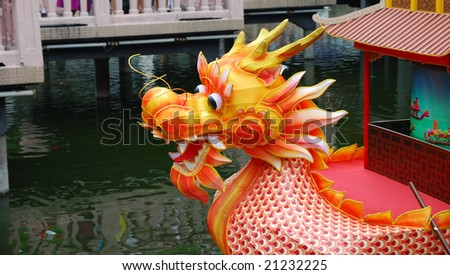 Boat with head of dragon in holidays - stock photo