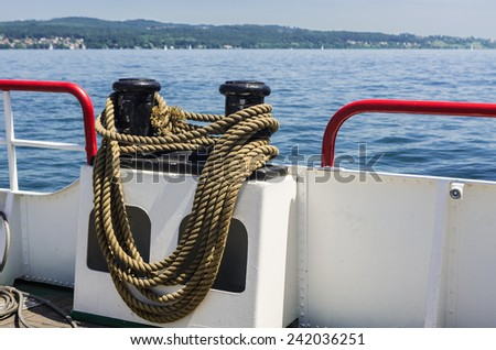 Boat with mooring rope around a bollard on board.
