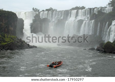 Boat with people in Iguazu waterfalls - Argentina. Iguazu Falls is the most visited place in Argentina. - stock photo