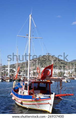 Boat with turkish red flag in Bodrum, Turkey - stock photo