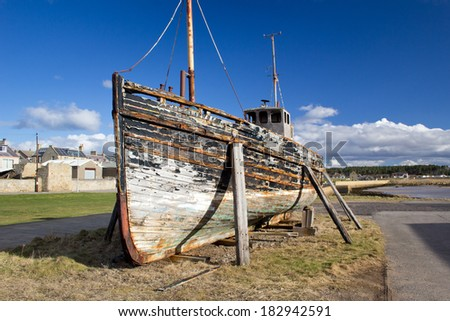 Boat wreck at Burghead Harbour, Highlands of Scotland. - stock photo