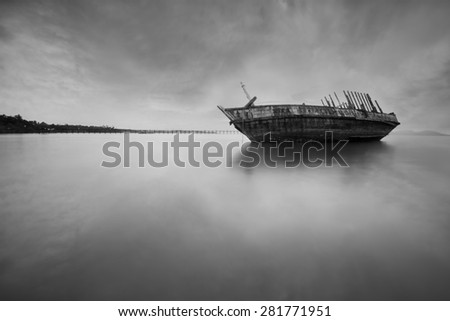 boat wreck in thailand black and white tone. - stock photo