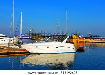 boat yacht moored to the pier - stock photo