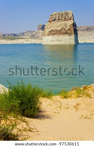 Boaters driving around Lone Rock on Lake Powell, Page, AZ. - stock photo