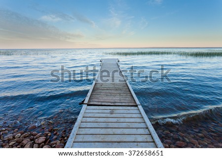 Boating dock at shore of large Lesser Slave Lake in Alberta, Canada - stock photo