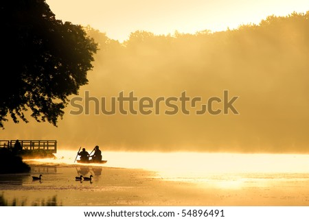 Boating into the Fog at Sunrise - stock photo