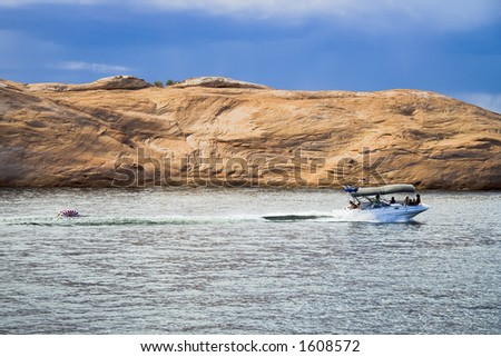 Boating on Lake Powell in Glen Canyon National Recreation Area Utah - stock photo