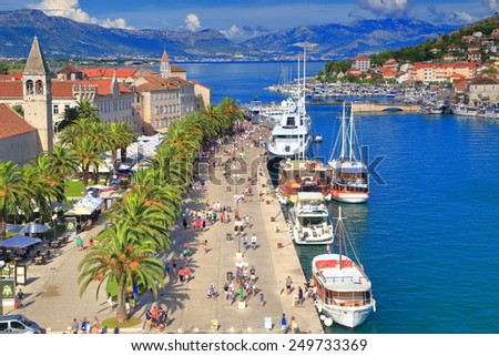 Boats aligned to the pier of old Venetian old near the Adriatic sea, Trogir, Croatia - stock photo