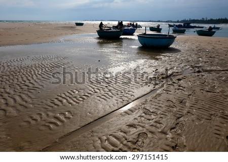 Boats anchor near Ke ga lighthouse in Binhthuan, Vietnam - stock photo