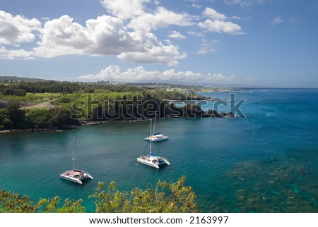 Boats anchored at a pristine Bay in Maui, Hawaii - stock photo