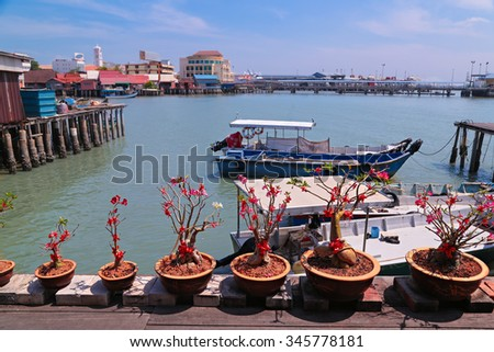Boats anchored at Chew jetty, one of Penang UNESCO Heritage site, Malaysia. - stock photo