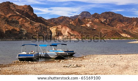 boats and colorado river - stock photo