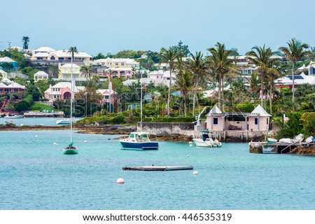 Boats and colorful architecture along the shoreline in Hamilton Bermuda. - stock photo