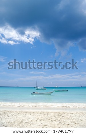 Boats and exotic beach at Saona Island, The Dominican Republic - stock photo