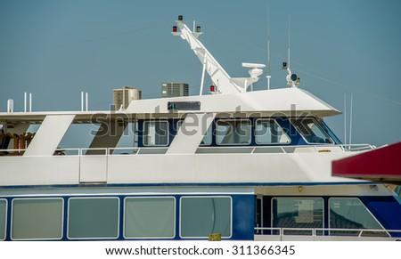 boats and fishing boats in the harbor marina - stock photo
