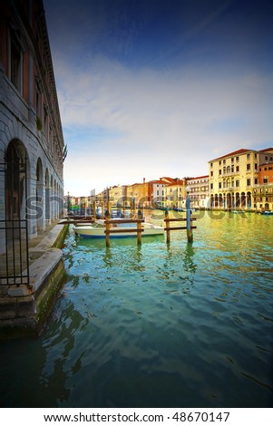 Boats and gondolas on the Grand Canal of Venice, Italy. - stock photo