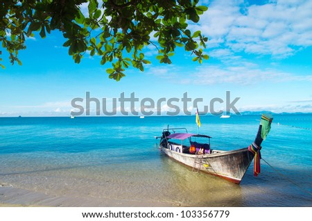 boats and islands in andaman sea Thailand - stock photo