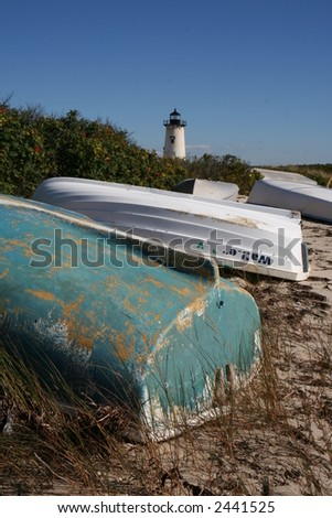 Boats and lighthouse- Martha's Vineyard - stock photo
