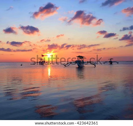 Boats and sea, sunset time, soft light, fisherman boat in sunset sea, boat on sunset, sea horizon during sunset, still sea & boat, catamaran boat in sea, Bali sea on sunset, orange sunset sky and sea - stock photo