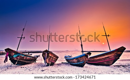 boats and sunset - stock photo