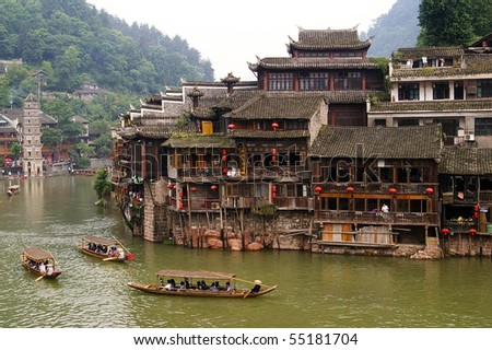 boats and wooden houses at Phoenix Town - the one the four most attractive small towns in China, next to Tuojiang - stock photo