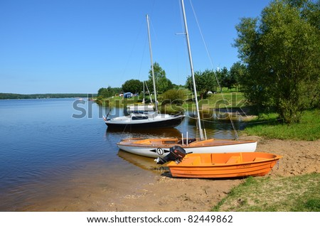Boats and yachts in small bay of Chancza lake