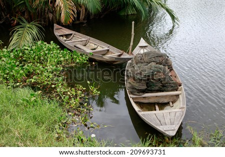 Boats are anchoring side by side on the river near Hoi An city, central of Vietnam, Hoi An is recognized as a World Heritage Site by UNESCO  - stock photo