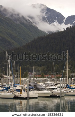 Boats are docked in Alaska's Seward Harbor - stock photo