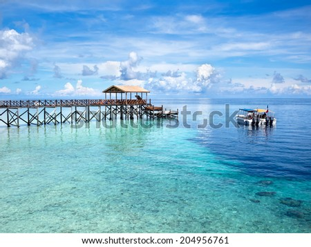Boats at dive site off of the coast of world famous Pulau Sipadan island in Sabah, East Malaysia. - stock photo