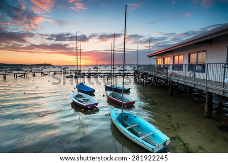 Boats at high tide at Sandbanks in Poole Harbour in Dorset - stock photo