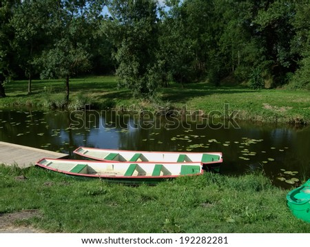 Boats at lakeside, Dinan, Cotes-D'Armor, Brittany, France - stock photo