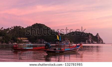Boats at late sunset, Koh Tao, Thailand. - stock photo