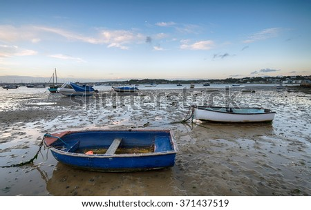 Boats at low tide on the beach at Sandbanks in Poole, Dorset - stock photo