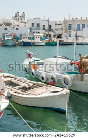 Boats at Naoussa harbor in Greek island of Paros - stock photo