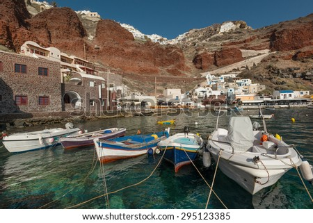 Boats at popular fishing village in Ammoudi Bay in Santorini, Greece - stock photo