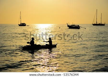 Boats at sunset time, Trang, Thailand - stock photo