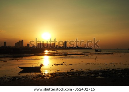Boats at the beach during sunset