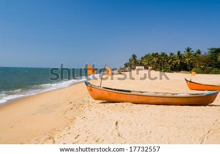 Boats at the beach of Ullal village near Mangalore, Karnataka, India - stock photo