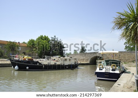 Boats at the Canal de Midi at the village of Capestang in Southern France - stock photo