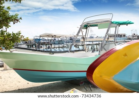 boats colorful in Isla Mujeres beach Mexico Mayan Riviera Cancun - stock photo