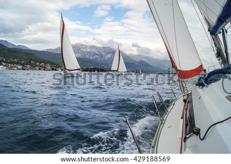 "Boats coming from the roll. Tivat, Montenegro - 26 April, 2016. Regatta ""Russian stream"" in God-Katorskaya bay of the Adriatic Sea off the coast of Montenegro."