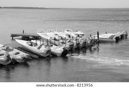 Boats docked at a marina in black and white