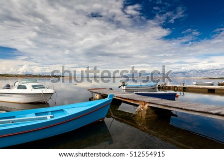 Boats docked in the harbor background beautiful skies with white clouds
