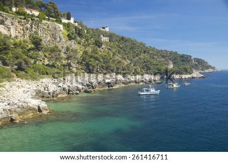 Boats docked near hillside on French Riviera, France - stock photo